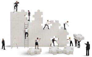 Business Team Assembling Pieces